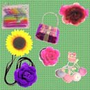SELF FABRIC FLOWER BROOCHES AND HAIR ACCESSORIES IN PVC BAGS (Hong Kong)